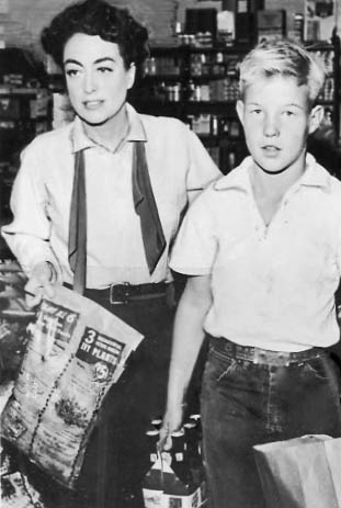 1954. On the set of 'Johnny Guitar' with son Chris. (Thanks to Bryan Johnson.)