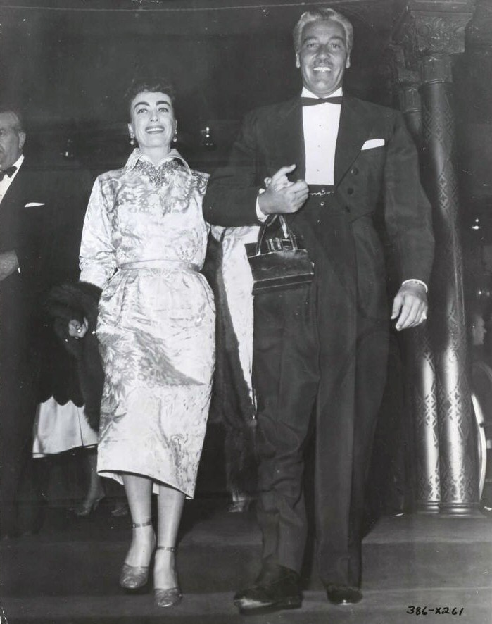 9/29/54. At the 'Star Is Born' after-party with Cesar Romero at the Cocoanut Grove.