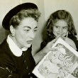November 1955. Two candids reading to kids at the Southside Day Care Center in St. Louis, Missouri.