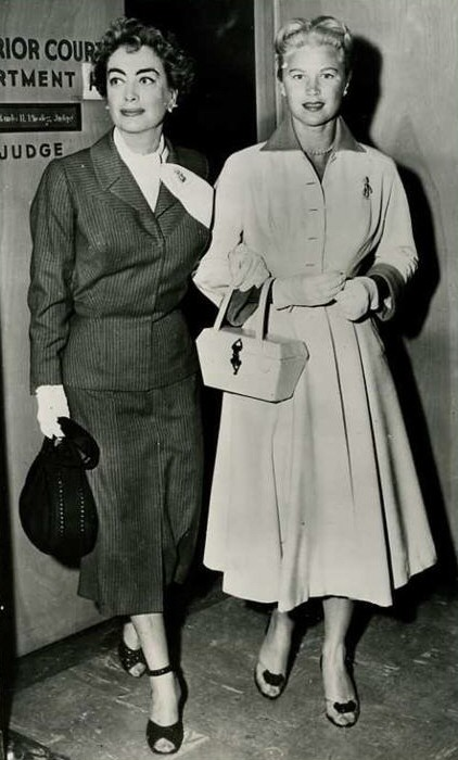 1956. With Joan Caulfield, testifying at the trial of furrier Teitelbaum.