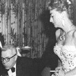 April 24, 1957. Celebrating Al's birthday at '21' in NYC. Mrs. Alfred Bloomingdale is to left.