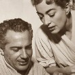 1957. With Rossano Brazzi on the set of 'Esther Costello.'