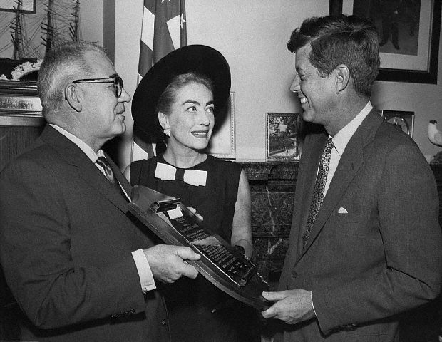 April 17, 1959. Al Steele presents Senator Kennedy with Multiple Sclerosis Society award.