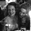 1959. Joan with former nemesis Norma Shearer, and producer Jerry Wald, in Hollywood.