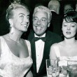 April 1962. With Cesar Romero and Carolyn Jones. (Includes press caption.)
