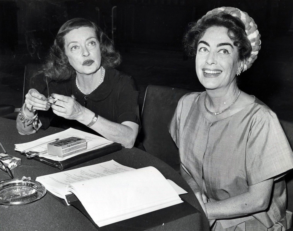 July 1962. On the set of 'Baby Jane' with Bette Davis.