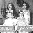 1962. On the 'Baby Jane' set with the girls who played the younger Bette and Joan characters.