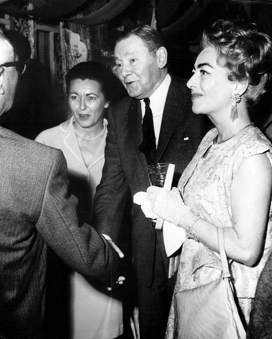 1962. At a Hollywood party in her honor, with Mr. and Mrs. Herbert Marshall.