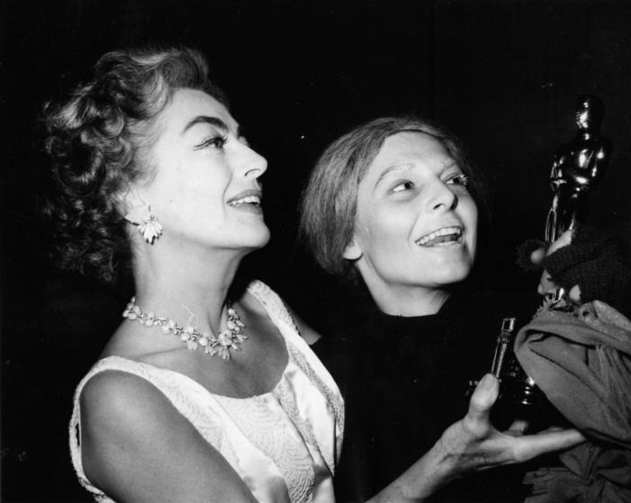 May 1963. Delivering the Oscar to Anne Bancroft on the set of 'Mother Courage.' (Thanks to Matt Treadaway.)