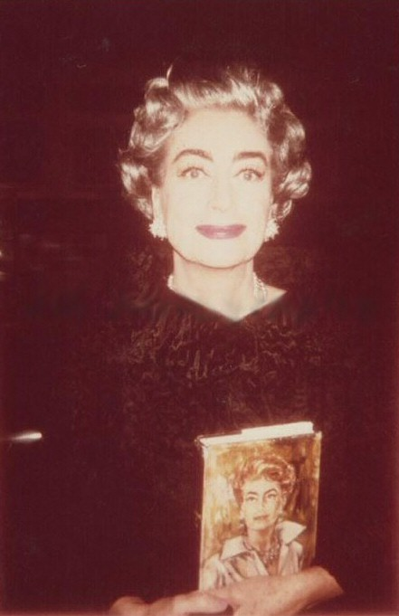 1963, with a copy of 'Portrait of Joan.'