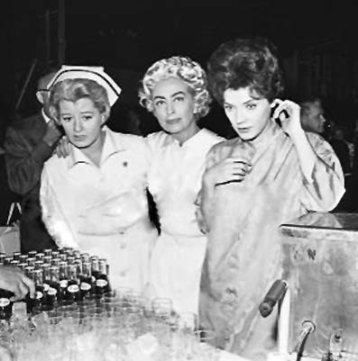 1963. On 'The Caretakers' set, with Constance Ford and Polly Bergen. (Thanks to Bryan Johnson.)