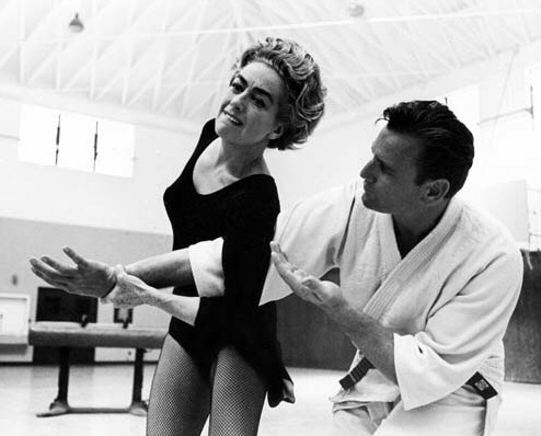 1963. On the set of 'The Caretakers' with jujitsu instructor Bruce Tegnor.