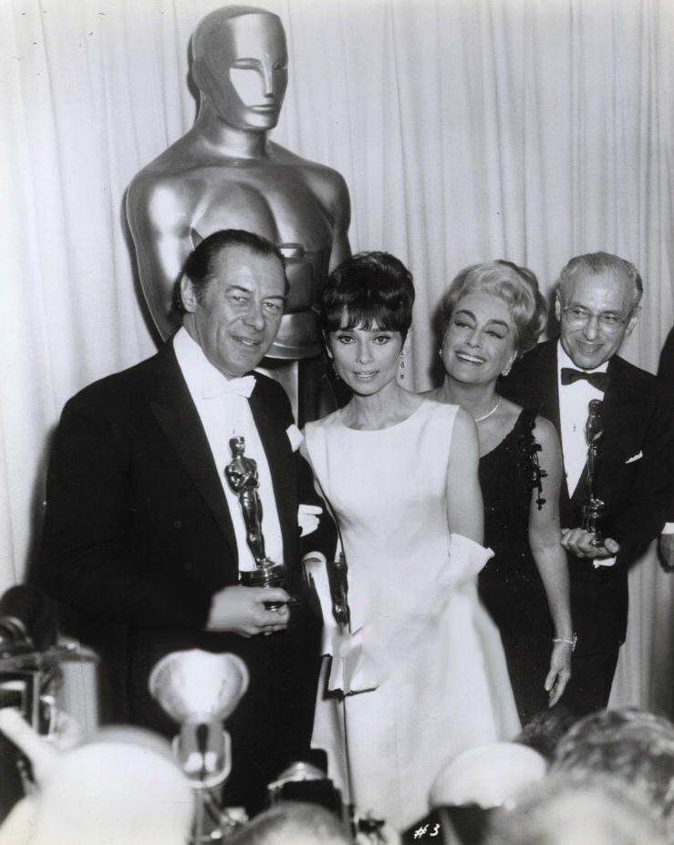 At the 4/5/65 Oscars with Rex Harrison, Audrey Hepburn, and George Cukor.