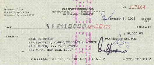 Warners tax check to Joan. (See below photo for endorsement on back.)