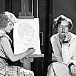 1929, being sketched by 'Our Modern Maidens' co-star Anita Page.