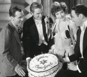 Director Jack Conway, left, celebrates Joan's birthday on the set of 1929's 'Our Modern Maidens' with Doug Fairbanks Jr and Rod LaRocque (right).