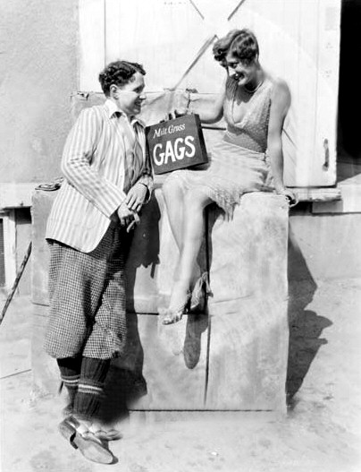 1928. With Charlie Chaplin on the set of 'Four Walls.'