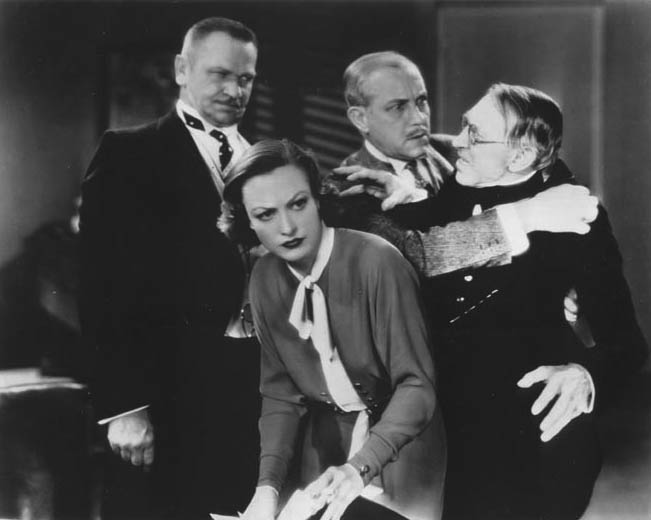 With Wallace Beery, left, and unknown.