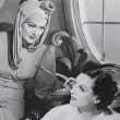 With Rosalind Russell.