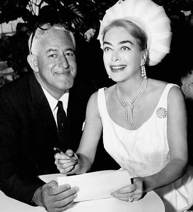 9/29/64. With director William Castle at the contract signing for 'I Saw What You Did.' (Thanks to Bryan Johnson.)
