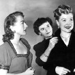 1950. Joan, costumer Sheila O'Brien, and Joan's 'protegee' Marion Morgan, on the set of 'Damned Don't Cry.'