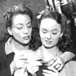 1945. Knitting with Ann Blyth on the set of 'Mildred.'