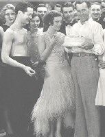 Conway celebrates his birthday on the set of 'Untamed' with Robert Montgomery and Joan.