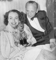 At home with Curtiz on Oscar night, 1946.