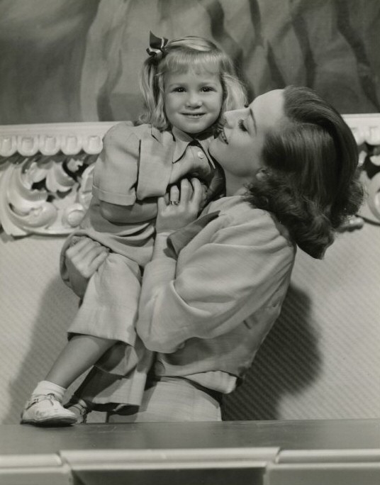 1937 with niece Joanie LeSueur. Shot by Hurrell. (Thanks to HB.)