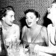 1952. Joan, Judy Garland, and Jane Wyman whoop it up at Romanoff's.