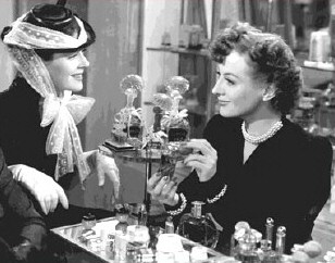 One of Joan's actual shopgirl roles of the '30s: Crystal Allen in 'The Women.' Here, with Rosalind Russell.