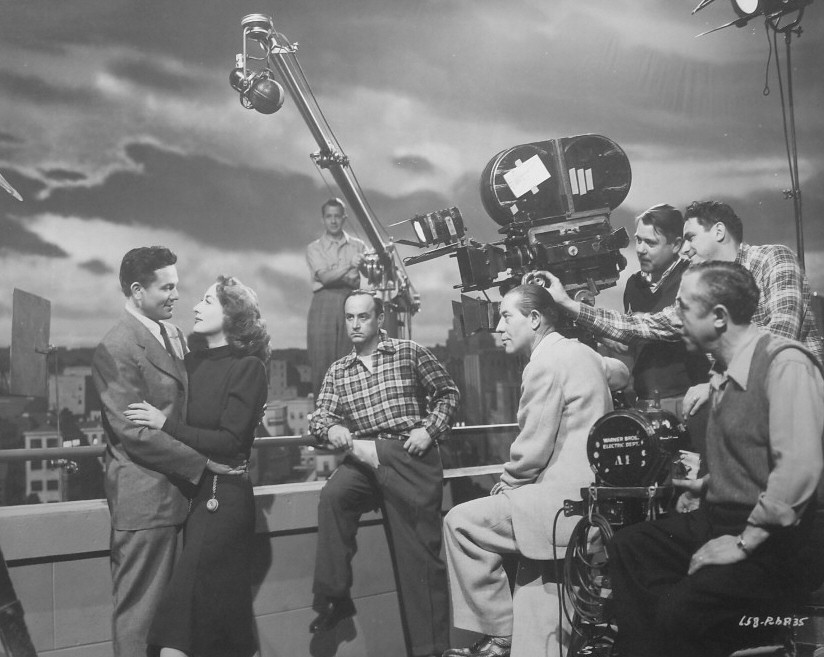 1946. On the set of 'Humoresque' with John Garfield and crew.