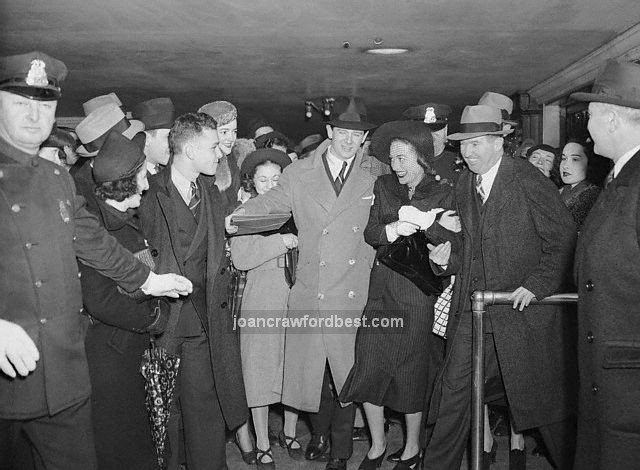 4/9/38. Joan with fans in NYC.