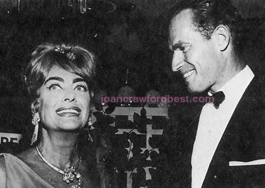 July 1962. With Charleton Heston at the International Press Honors Awards show.