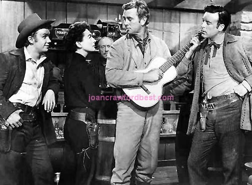 From left: Ben Cooper, Joan, Sterling Hayden, Scott Brady.