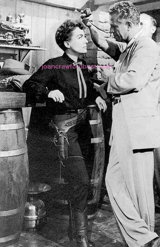 On the 'Johnny Guitar' set with director Nicholas Ray.