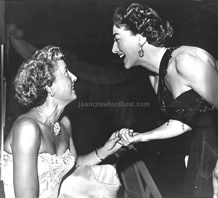 Circa 1952. Joan with Barbara Stanwyck at unknown event.