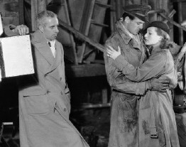 Hawks directing Gary Cooper and Joan on the set of 'Today We Live,' 1933.